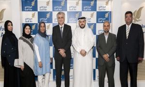 Dr. Jassim Haji and Ahmed Al Kuwaiti seen alongside members of Gulf Air's Management Committee and National Labour Union of Gulf Air